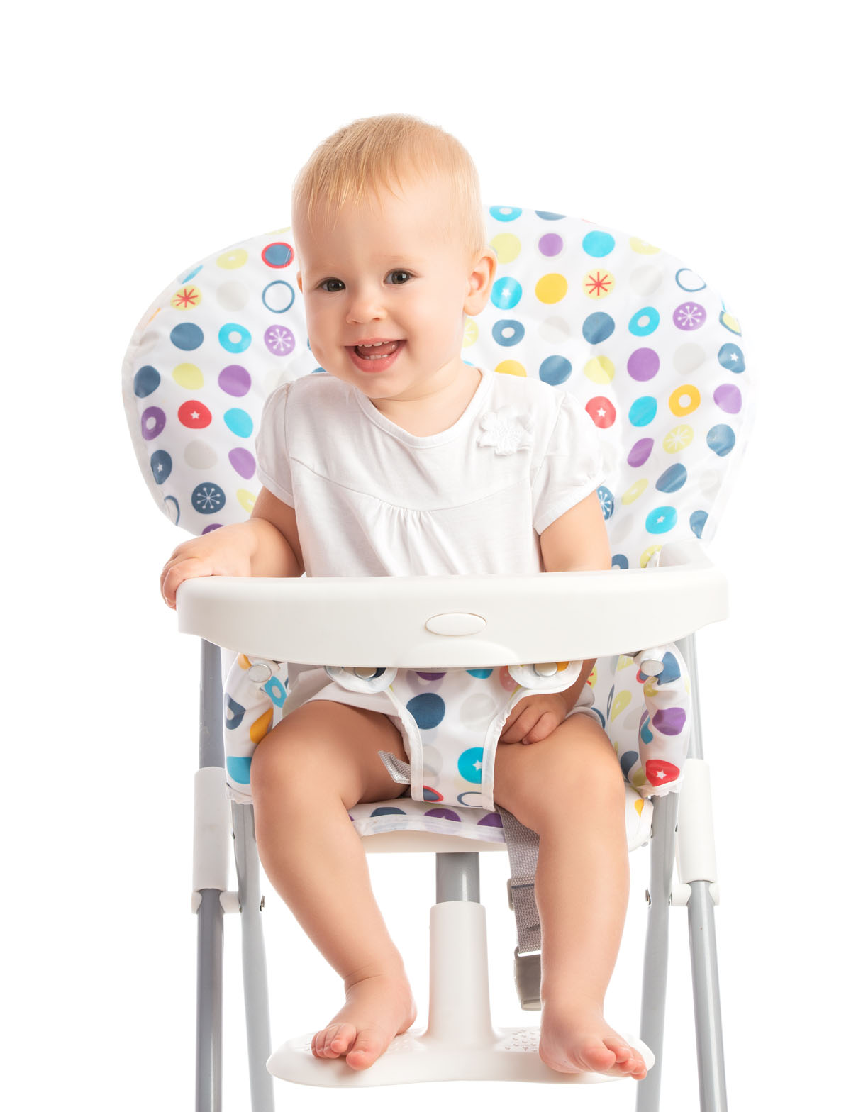happy baby sitting in a high chair isolated on white background